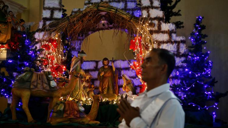 "A Christmas manger is on display inside a church during the 4th day of Christmas vigil mass, known locally as ""Misa de Gallo"" in Tacloban city"