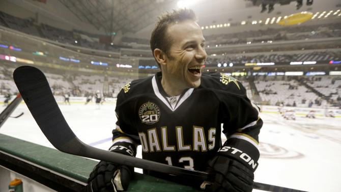 Dallas Stars left wing Ray Whitney (13) laughs as he warms up before the NHL hockey game against the Phoenix Coyotes Saturday, Jan. 19, 2013, in Dallas. (AP Photo/LM Otero)