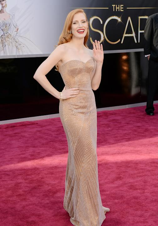 Jessica Chastain hit the red carpet in a nude gown with a delicate silver thread pattern overlay©Getty