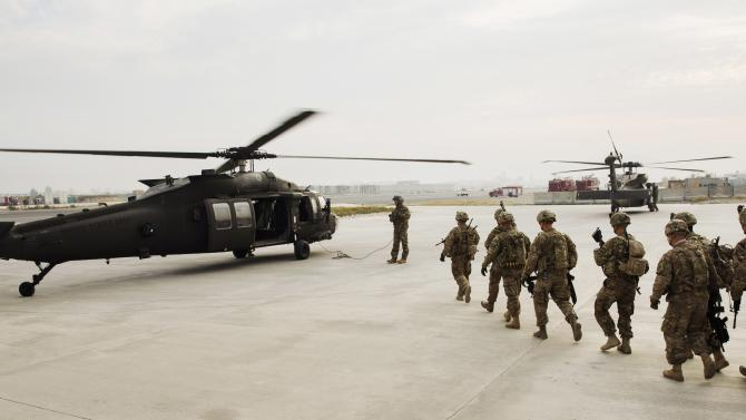 U.S. soldiers from the 3rd Cavalry Regiment load into a UH-60 Blackhawk helicopter for a mission at Forward Operating Base Fenty in the Nangarhar province of Afghanistan