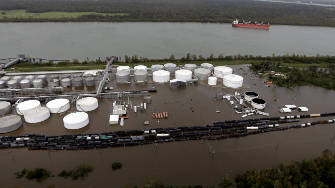 This aerial photo shows a flooded chemical plant along the Mississippi River in Braithwaite, La., in the aftermath of Isaac Friday, Aug. 31, 2012. Isaac is now a tropical depression, with the center on track to cross Arkansas on Friday and southern Missouri on Friday night, spreading rain through the regions. (AP Photo/David J. Phillip)
