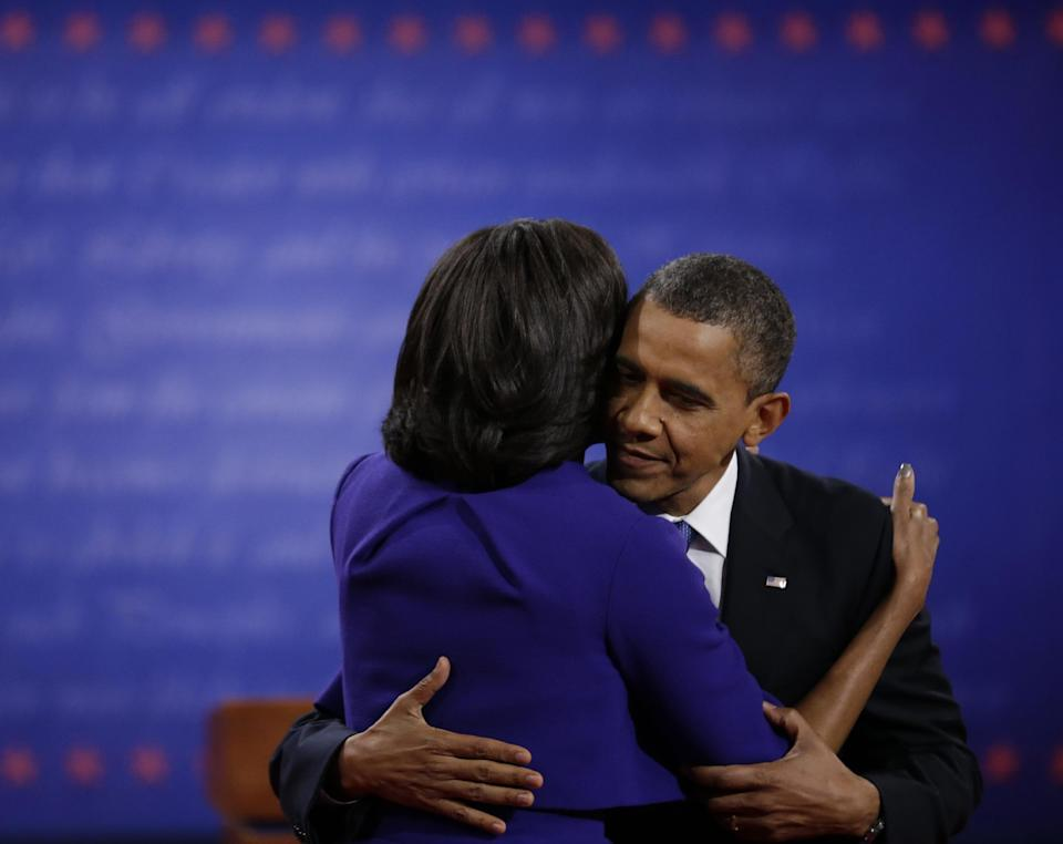 President Barack Obama hugs his wife Michelle following the first presidential debate at the University of Denver, Wednesday, Oct. 3, 2012, in Denver. (AP Photo/David Goldman)