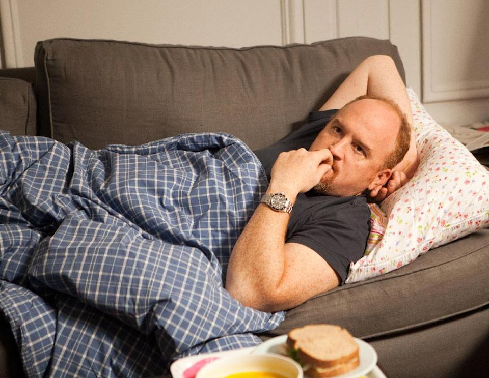 "This image released by FX shows Louis C.K. in a scene from ""Louie."" Louis C.K. is nominated for an Emmy Award for best actor in a comedy series. The Academy of Television Arts & Sciences' Emmy ceremony will be hosted by Neil Patrick Harris. It will air Sept. 22 on CBS. (AP Photo/FX)"