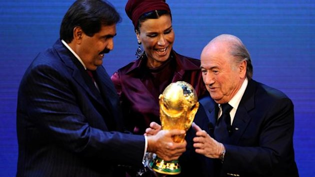 FIFA President Josef Blatter (R) hands over the World Cup trophy to the Emir of the State of Qatar Sheikh Hamad bin Khalifa Al-Thani (L) and his wife Chair of Qatar Foundation for Education, Science and Community development Sheikha Moza bint Nasser Al-Mi