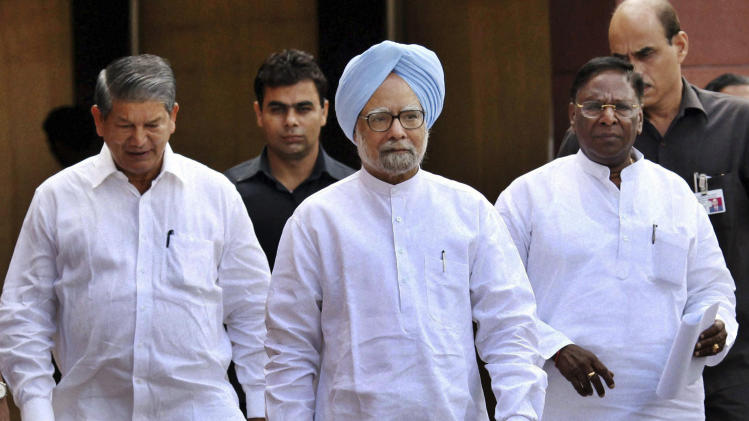 Indian Prime Minister Manmohan Singh, center, arrives to address the media on the last day of the Indian Parliament's monthlong session in New Delhi, India, Friday, Sept. 7, 2012. The latest session of India's often-raucous Parliament has been adjourned after weeks of shouting matches between the country's beleaguered government and the opposition. The session ended Friday with only four out of 30 slated bills passed. (AP Photo) INDIA OUT