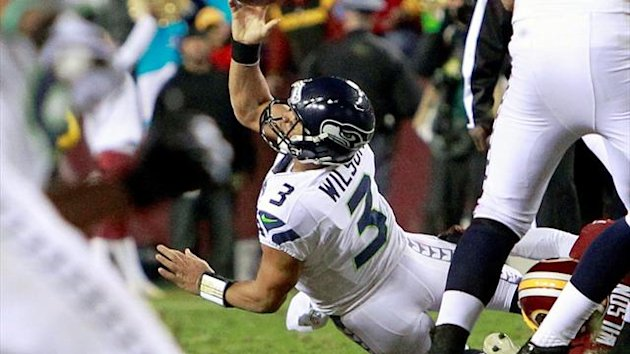 Seattle Seahawks quarterback Russell Wilson (3) passes off under pressure by the Washington Redskins (Reuters)
