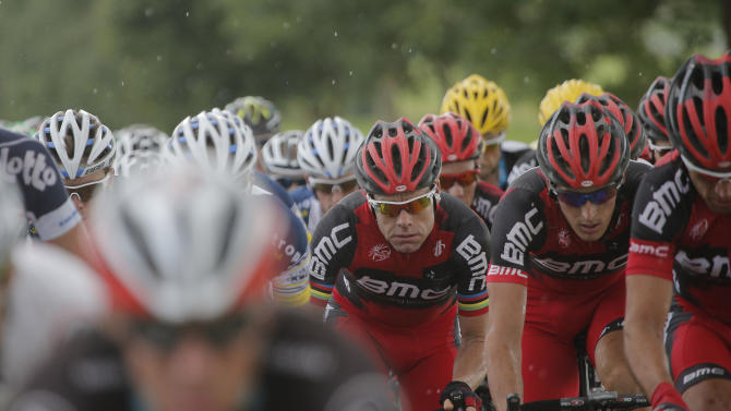 Cadel Evans of Australia, 2011 Tour de France winner, third from right, rides in the pack during the sixth stage of the Tour de France cycling race over 207.5 kilometers (129 miles) with start in Epernay and finish in Metz, France, Friday July 6, 2012. (AP Photo/Christophe Ena)