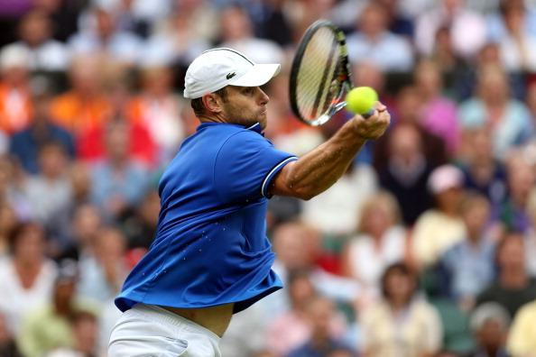 Andy Roddick of the United States returns a shot to Novak Djokovic of Serbia during the second round of Men's Singles Tennis on Day 4 of the London 2012 Olympic Games at Wimbledon on July 31, 2012 in London, England. (Photo by Clive Brunskill/Getty Images)