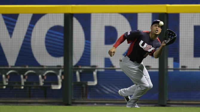 United States right fielder Giancarlo Stanton catches a fly ball hit by Italy's Chris Denorfia during the first inning of a World Baseball Classic game Saturday, March 9, 2013, in Phoenix. (AP Photo/Charlie Riedel)