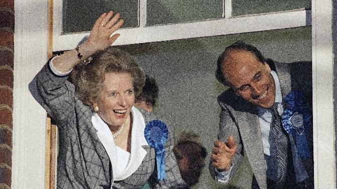 """FILE - In this June 12, 1987 file photo, British Prime Minister Margaret Thatcher waves to supporters from Conservative Party headquarters in London after claiming victory in Britain's general election. Ex-spokesman Tim Bell says that Thatcher has died. She was 87. Bell said the woman known to friends and foes as """"the Iron Lady"""" passed away Monday morning, April 8, 2013. (AP Photo/File)"""