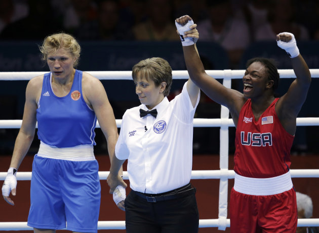 The United States' Claressa Shields, in red, celebrates after winning her fight against Russia's Nadezda Torlopova, in blue, during the women's middleweight 75-kg boxing gold medal match at the 2012 Summer Olympics, Thursday, Aug. 9, 2012, in London. (AP Photo/Patrick Semansky)
