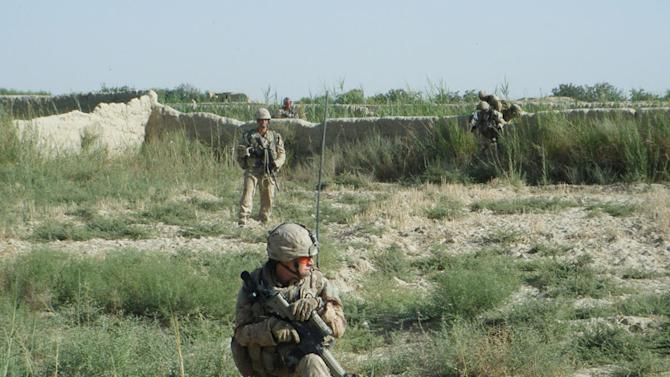 In this 2010 photo provided by Canadian Armed Forces Capt. Ashley Collette, she, foreground, and her soldiers patrol in Afghanistan. During her 10-month deployment in Afghanistan, Collette led a 50-strong all-male infantry unit providing security to villagers. (AP Photo/Capt. Ashley Collette)