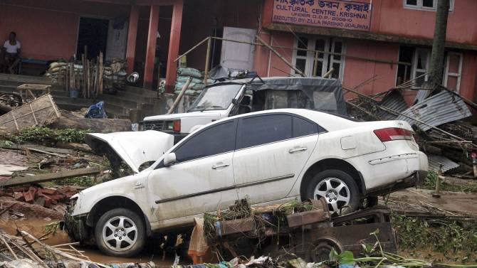 Vehicles damaged by the flood waters are pictured at Goalpara district after heavy rains in Assam