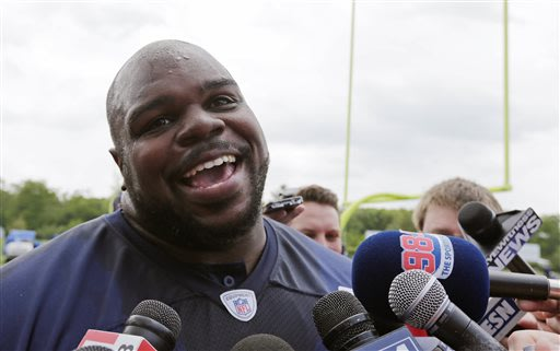 New England Patriots nose tackle Vince Wilfork smiles as he talks with reporters following an NFL football team practice in Foxborough, Mass., Tuesday, May 21, 2013