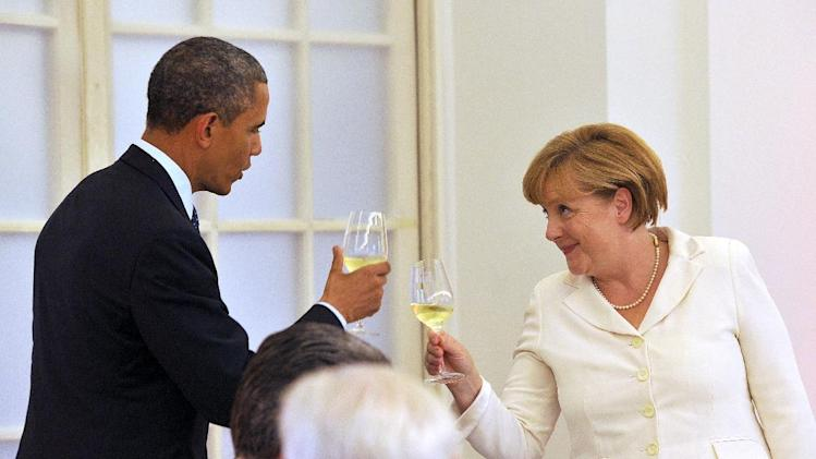US President Barack Obama (L) toasts with German Chancellor Angela Merkel during a state dinner at the Schloss Charlottenburg in Berlin, Germany, on June 19, 2013