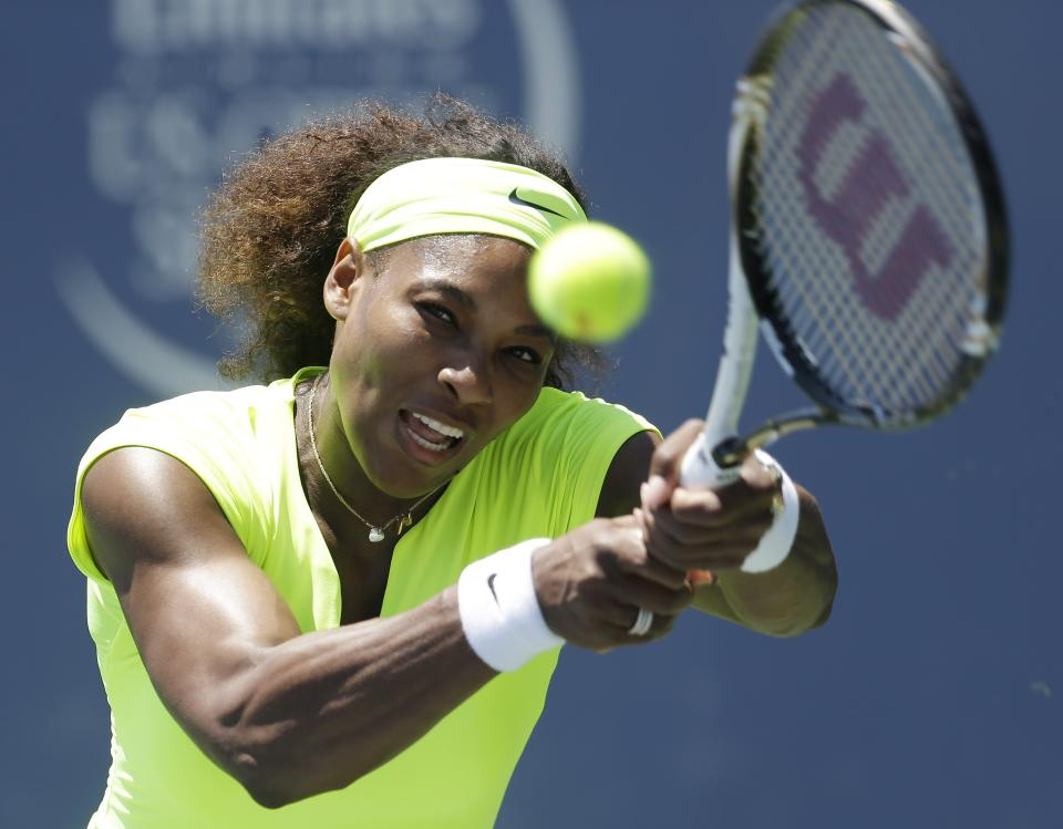 Serena Williams, of the United States, returns to Coco Vandeweghe, of the United States, during the final of the Bank of the West tennis tournament on Sunday, July 15, 2012, in Stanford, Calif. (AP Photo/Marcio Jose Sanchez)