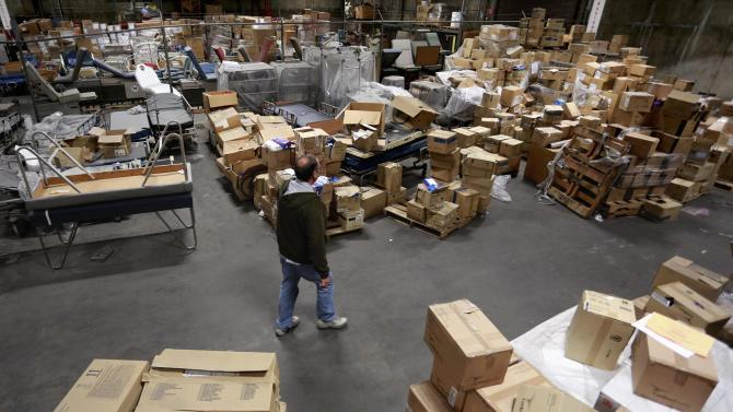 Operation USA warehouse manager Bruce Brinker walks through warehouse filled with relief shipments in Wilmington, California