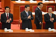 Chinese Vice Premier Li Keqiang (2nd R) walks past President Hu Jintao (L), Vice President Xi Jinping (2nd L) and Premier Wen Jiabao (R) as they arrive at the opening session of the Chinese National People's Congress (NPC) at the Great Hall of the People in Beijing on March 5, 2013. China has targeted economic growth of 7.5% in 2013 and vowed an unwavering fight against corruption