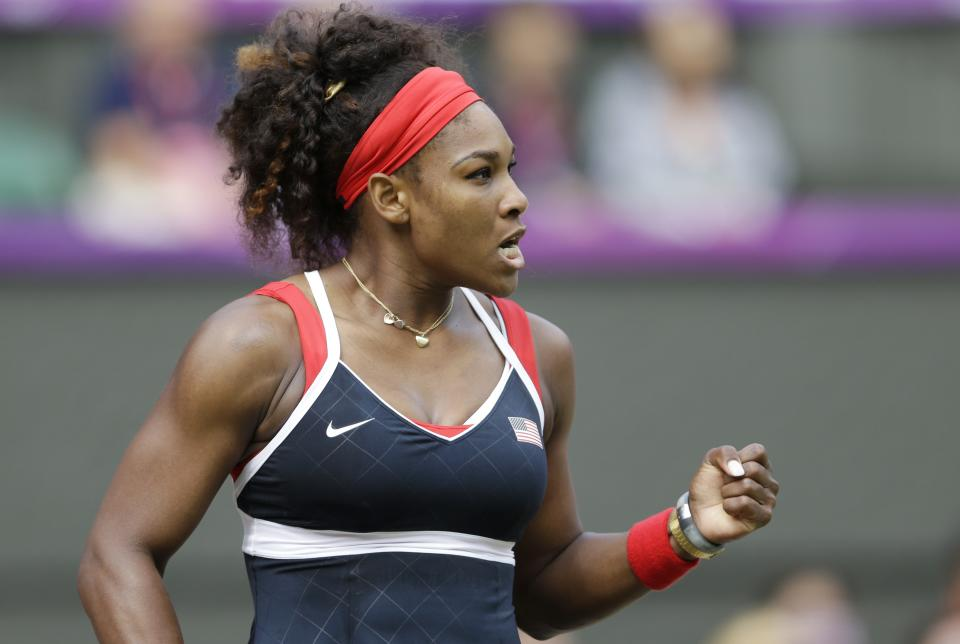 United States' Serena Williams reacts during her women's singles gold medal match against Maria Sharapova of Russia at the All England Lawn Tennis Club at Wimbledon, in London, at the 2012 Summer Olympics, Saturday, Aug. 4, 2012. Williams defeated Sharapova, winning the gold medal.(AP Photo/Victor R. Caivano)