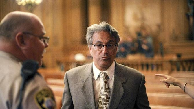 Suspended San Francisco Sheriff Ross Mirkarimi arrives at a Board of Supervisors meeting on Tuesday, Oct. 9, 2012, in San Francisco. The supervisors planned to vote on removing Mirkarimi from office following a domestic violence incident between Mirkarimi and his wife Eliana Lopez. (AP Photo/Noah Berger)