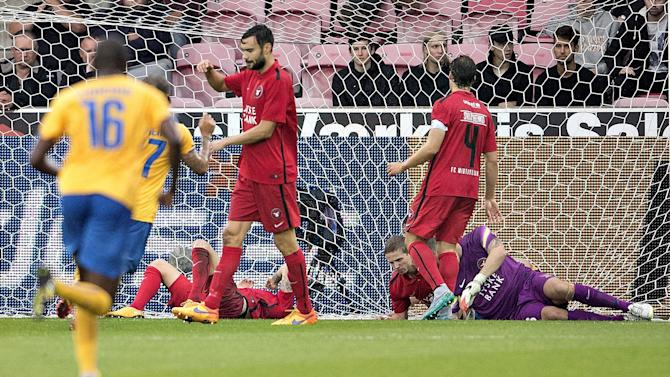 Players react after Apoel FC scored a goal against FC Midtjylland during their Champions League third qualifying round in the MCH Arena, Herning, Denmark