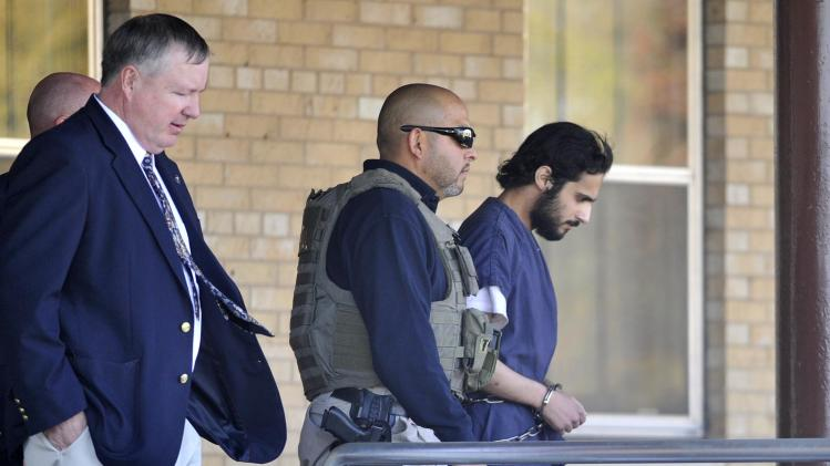 CORRECTS NAME TO KHALID ALI-M ALDAWSARI, NOT KHALID ALI-ALDAWSARI - Khalid Ali-M Aldawsari, 22, right, is escorted from the federal courthouse in Amarillo, Texas by U.S. Marshals Tuesday Nov. 13, 2012 after being sentenced to life in prison on a federal charge of attempting to use a weapon of mass destruction in a Lubbock-based bomb-making plot. (AP Photo/Amarillo Globe-News, Michael Schumacher)  MANDATORY CREDIT; MAGS OUT; TV OUT;