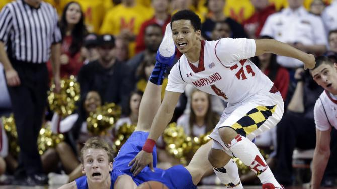 Duke forward Alex Murphy, left, and Maryland guard Seth Allen chase after a loose ball in the second half of an NCAA college basketball game in College Park, Md., Saturday, Feb. 16, 2013. Maryland won 83-81. (AP Photo/Patrick Semansky)