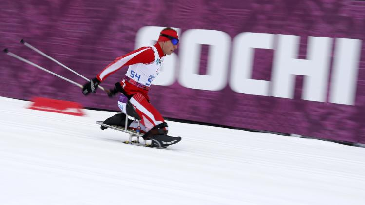 Poland's Rosiek skis during the men's 15 km biathlon sitting at the 2014 Sochi Paralympic Winter Games in Rosa Khutor