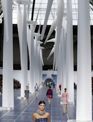 A model presents a creation for Chanel during the Spring/Summer 2013 ready-to-wear collection show on October 2, 2012 at the Grand Palais in Paris