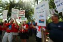 Teachers from Wisconsin and Minnesota join striking Chicago teachers during a rally Saturday, Sept. 15, 2012, in Chicago. Union president Karen Lewis reminded the crowd that although there is a