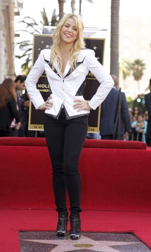 Colombian singer Shakira poses as she is honored with a star on the Hollywood Walk of Fame in Los Angeles Tuesday, Nov. 8, 2011. (AP Photo/Damian Dovarganes)
