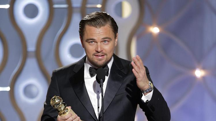 "This image released by NBC shows Leonardo DiCaprio accepting the award for best actor in a motion picture comedy for his role in ""The Wolf of Wall Street"" during the 71st annual Golden Globe Awards at the Beverly Hilton Hotel on Sunday, Jan. 12, 2014, in Beverly Hills, Calif. (AP Photo/NBC, Paul Drinkwater)"