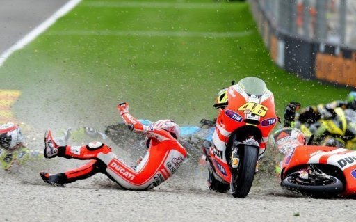 Ducati Team's US Nicky Hayden (C) falls during the MotoGP race