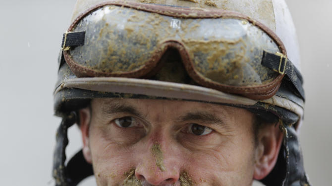 Jockey Shane Sellers walks off the track after riding Night Party in the ninth race during the 139th Kentucky Derby at Churchill Downs Saturday, May 4, 2013, in Louisville, Ky. (AP Photo/David J. Phillip)