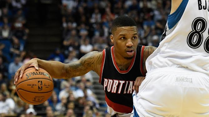Damian Lillard of the Portland Trail Blazers controls the ball during a game against the Minnesota Timberwolves on November 2, 2015 at Target Center in Minneapolis, Minnesota