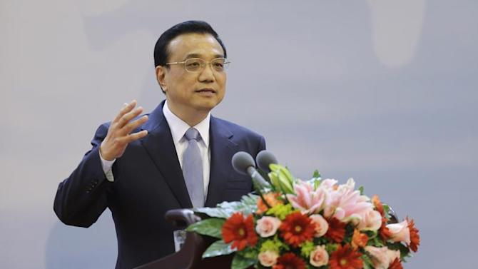 China's Premier Li delivers a speech during the opening ceremony of 21st Century Council Beijing Conference at the Great Hall of the People, in Beijing