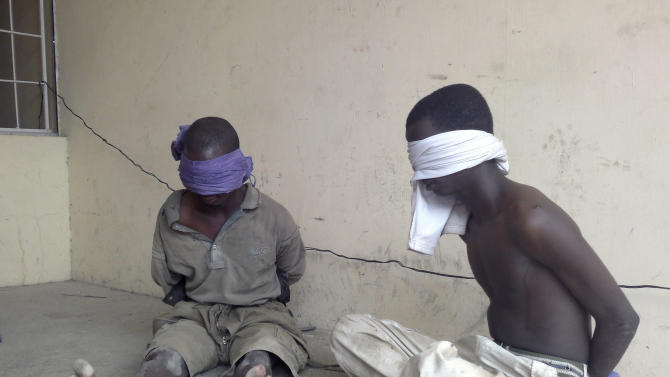 FILE:  In this Wednesday, March 21, 2012 file photo,  suspected members of the radical Islamist sect Boko Haram, are detained by the military, in Bukavu Barracks in Kano state, Nigeria after an attack on a police headquarters, the home of a senior police officer and setting fire to a nearby bank.  Now, Boko Haram seems to be growing ever-stronger, killing more people than ever before and slowly internationalizing their outlook, a possible danger for the rest of West Africa. More than 770 people have been killed in Boko Haram attacks so far this year, according to an Associated Press count, making 2012 the worst year of violence attributed to the group  (AP Photos/Salisu Rabiu-file)