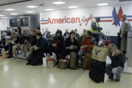 <p>               Passengers wait for their flight at at LaGuardia airport, Sunday, Oct. 28, 2012 in New York. Tens of thousands of residents were ordered to evacuate coastal areas Sunday as big cities and small towns across the Northeast buttoned up against the onslaught of a superstorm (AP Photo/Mary Altaffer)