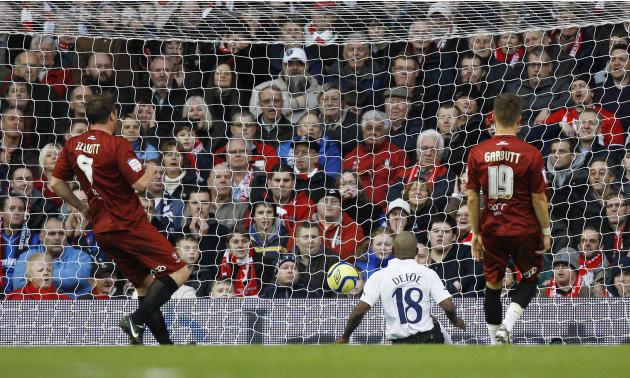 Tottenham's Jermain Defoe, center, scores a goal against Cheltenham during the FA Cup third round soccer match between Tottenham Hotspur and Cheltenham Town at White Hart Lane Stadium in London, Satur