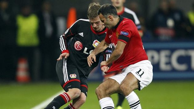 Lars Bender and Ryan Giggs (Reuters)
