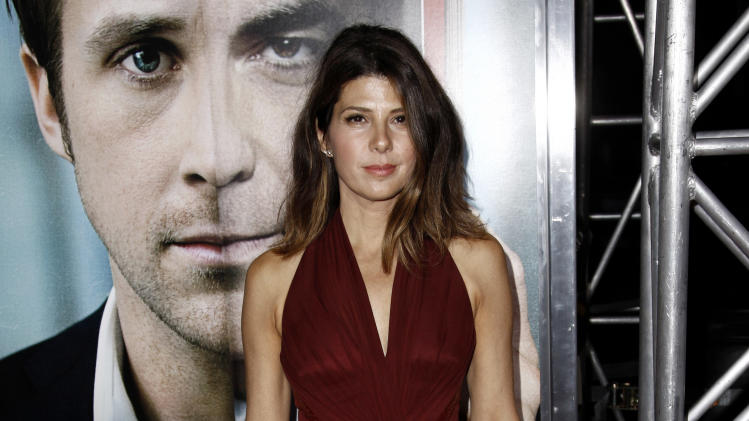 """Cast member Marisa Tomei arrives at the premiere of """"The Ides of March"""", in Beverly Hills, Calif., Tuesday, Sept. 27, 2011.  """"The Ides of March"""" opens in theaters Oct. 7, 2011. (AP Photo/Matt Sayles)"""