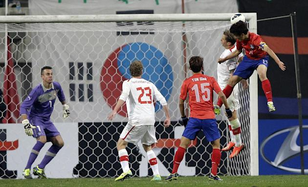 South Korea's Lee Chung-yong, right, scores a goal against Switzerland during their friendly soccer match at Seoul World Cup Stadium in Seoul, South Korea, Friday, Nov. 15, 2013. South Korea won 2-1