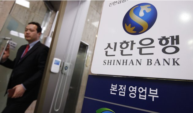 An employee leaves an office at a headquarters of Shinhan Bank in Seoul