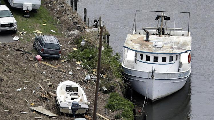 This aerial photo shows boats washed up on a road in Yscloskey, La., Friday, Aug. 31, 2012. Isaac is now a tropical depression, with the center on track to cross Arkansas on Friday and southern Missouri on Friday night, spreading rain through the regions. (AP Photo/David J. Phillip)
