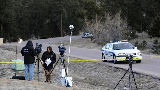 Journalists wait to report Wednesday morning, March 20, 2013, at the scene of an overnight shooting in Monument, Colo., that left Colorado Department of Corrections Director Tom Clements dead at his home. Clements was shot and killed Tuesday evening when he answered the front door of his house, and police are searching for the gunman. (AP Photo/The Colorado Springs Gazette, Mark Reis) MAGS OUT