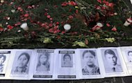 Pictures of people disappeared during civil war are displayed outside court in Guatemala City on January 28, 2013. Former dictator Efrain Rios Montt is accused of orchestrating the massacre of more than 1,750 indigenous Maya people during his time in power