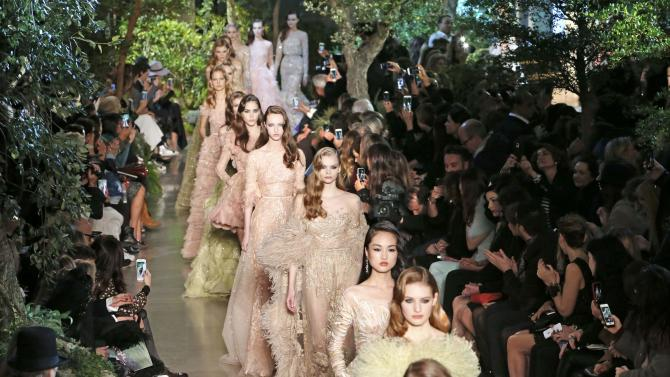 Models present creations by Lebanese designer Elie Saab as part of his Haute Couture Spring Summer 2015 fashion show in Paris