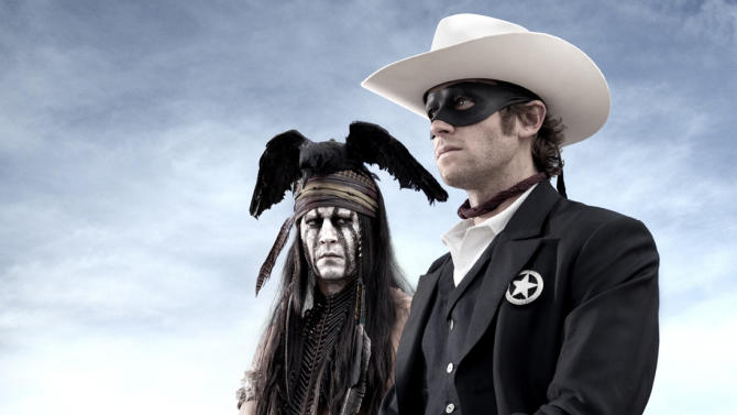 "FILE - This undated publicity photo from Disney/Bruckheimer Films, shows actors, Johnny Depp, left, as Tonto, a spirit warrior on a personal quest, who joins forces in a fight for justice with Armie Hammer, as John Reid, a lawman who has become a masked avenger, The Lone Ranger, from the movie, ""The Lone Ranger."" The film opens nationwide on July 3, 2013. (AP Photo/Disney/Bruckheimer Films, Peter Mountain, File)"