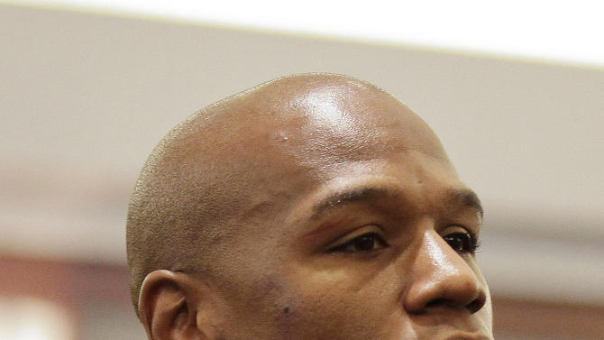 FILE - This Dec.. 21, 2011 file photo shows boxer Floyd Mayweather Jr.,  waiting for sentencing in Clark County District Court, in Las Vegas. Mayweather Jr. is due for release from a Las Vegas jail by the weekend, after serving two months in a domestic battery case. Records show the 35-year-old undefeated champion is due for release Friday Aug. 3, 2012, from the Clark County jail in downtown Las Vegas.  (AP Photo/Julie Jacobson, file)