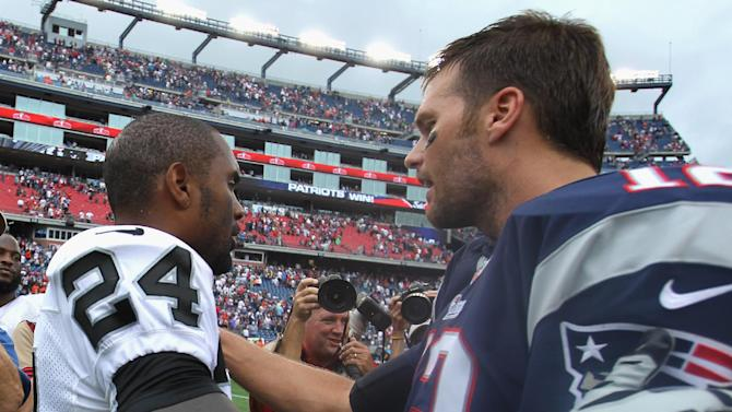 Charles Woodson (L) of the Oakland Raiders shakes hands with Tom Brady of the New England Patriots after their game at Gillette Stadium in Foxboro, Massachusetts, on September 21, 2014